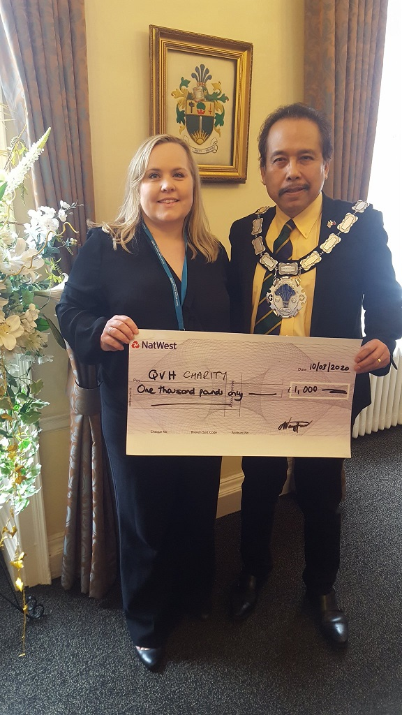 East Grinstead Mayor Danny Favor presents cheque from The Spitfire Society to QVH Charity on 10 March 2020.